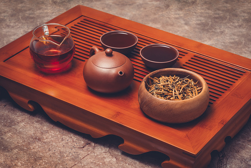 Chinese Tea In Yixing Clay Teapot With Teaware Stand On Tea Tray Stock Photo - Download Image Now