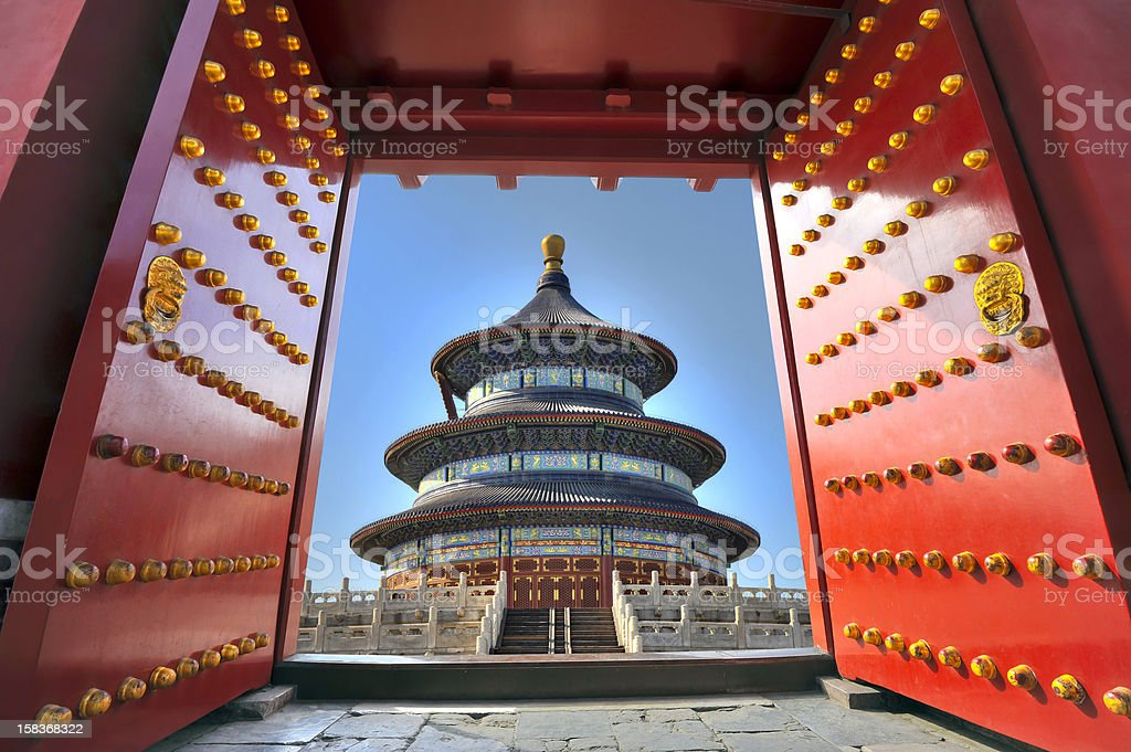 Chinese temple behind red gate doors stock photo