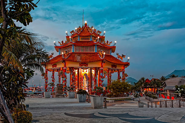 Chinese temple on Koh Loi Sunset view to shore with Guanyin Chinese shrine temple on Koh Loi at Sriracha, Chonburi province, Thailand sriracha tiger zoo stock pictures, royalty-free photos & images