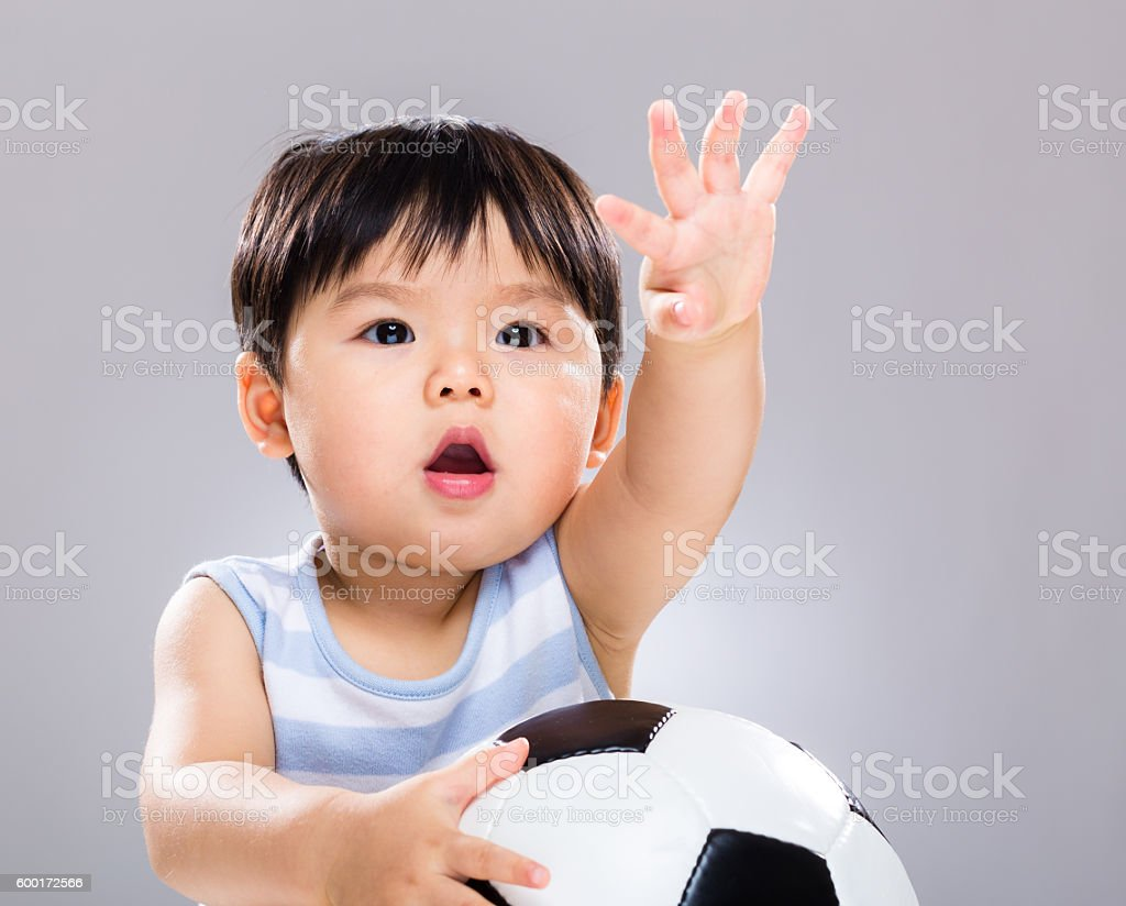 Chinese toddler with a football stock photo