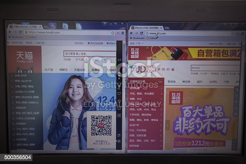 Guangzhou, China - November 11, 2013: With Electronic Business developing rapidly, most people visiting Chinese online shopping websites demonstrated on computer screen. Today the two main Chinese online shops(Jingdong,Tmall) fight each other in order to takes the larger proportion of the market.