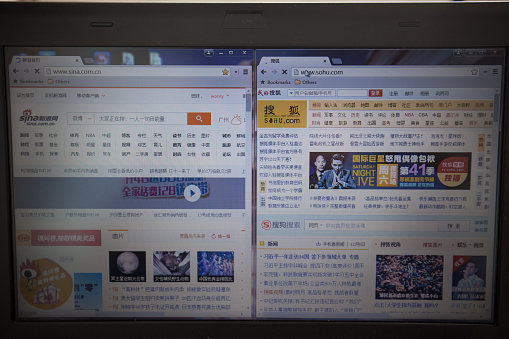 Guangzhou, China - November 11, 2013: With Electronic Business developing rapidly, most people visiting Chinese online portal websites demonstrated on computer screen. Today  top 2 Chinese portal websites are sina and sohu.