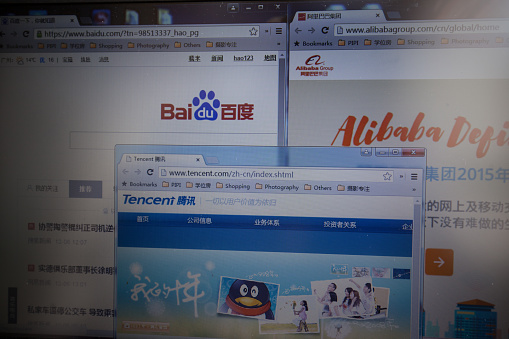Guangzhou, China - November 11, 2013: With internet developing rapidly, Today the three main Chinese corporations:Baidu, Alibaba, Tencent(QQ).
