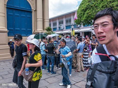 istock Chinese Tourist Group with Phones and Flags 544739628