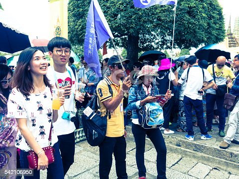 istock Chinese Tourist Group with Selfie Flags 542106950