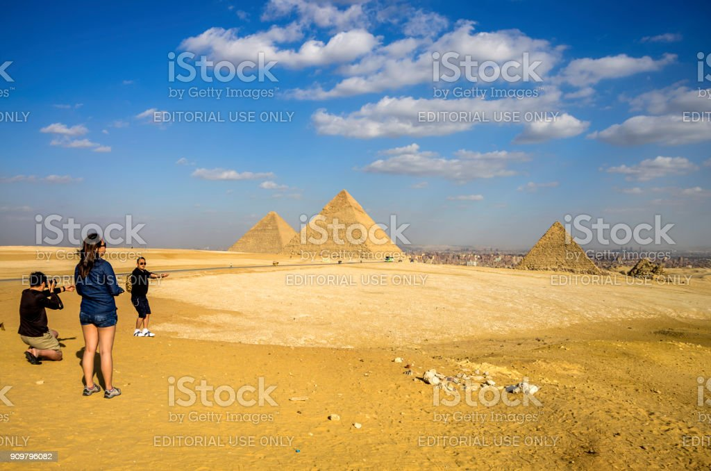 Chinese tourists in the Pyramids of Giza. Cairo, Egypt. stock photo