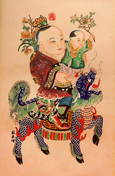 Chinesische traditionelle glückverheißende Gemälde-Eine junge auf einem Kylin – Foto