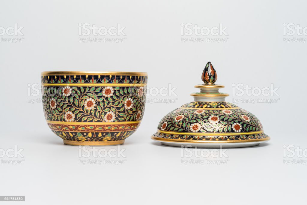 Chinese traditional ceramic crockery with flowers ornament, handmade. Isolated background Front view stock photo