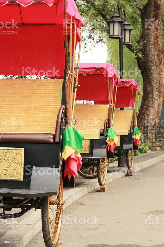Chinese traditional colorful chariots or Rickshaw stock photo
