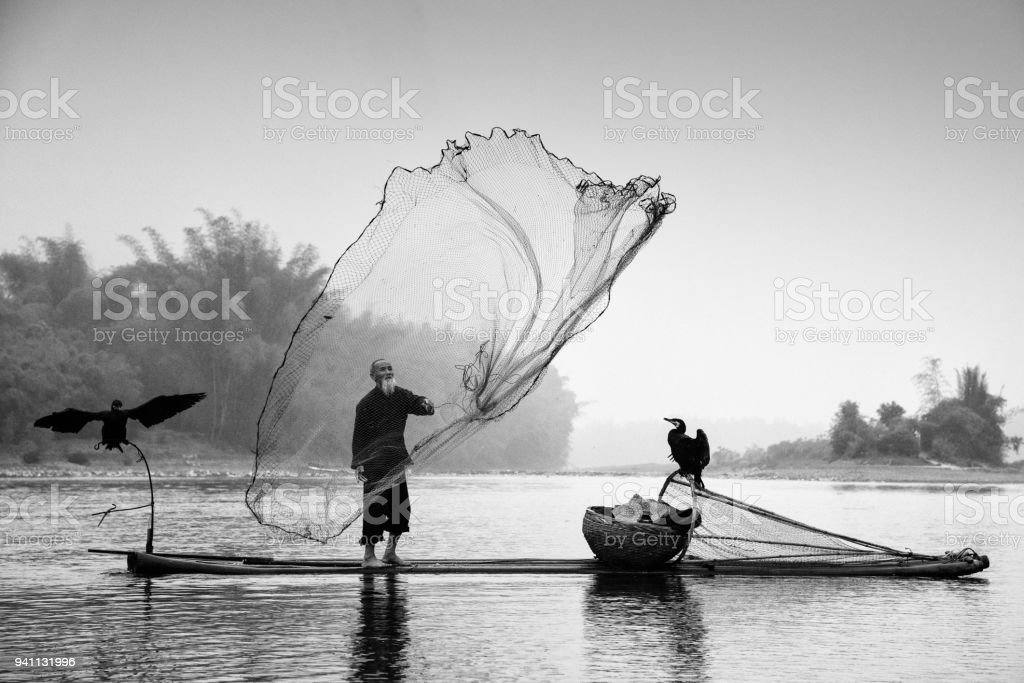Chinese traditional fisherman Li River China BW royalty-free stock photo