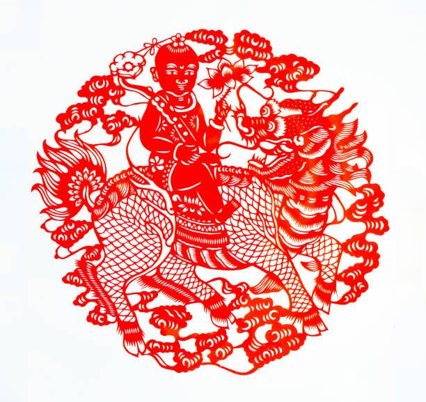 chinesische traditionelle papier geschnitten, chinesische einhorn papier geschnitten, viel glück symbol - vogel phönix tattoos stock-fotos und bilder