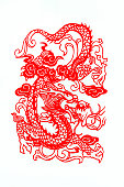 istock Chinese traditional paper cutting, Zodiac signs. Chinese New Year, Year of the Dragon. Chinese animal dragon traditional paper-cut art pattern. Dragon paper cut, Chinese New Year. 1203327047