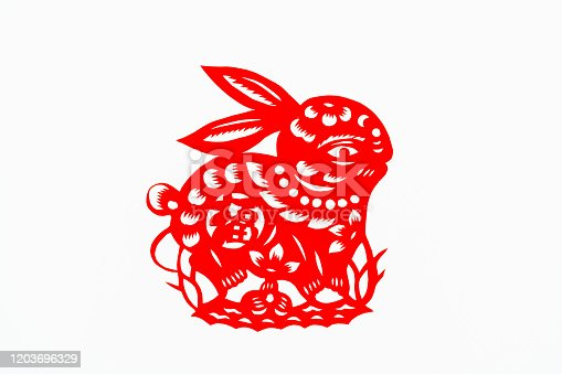 istock Chinese traditional paper-cut art pattern, tracery. lunar New Year. Year of the Rabbit. Symbol of happiness and good luck. Chinese auspicious elements. Chinese character translation (blessing, longevity, peace, wealth, cornucopia) 1203696329