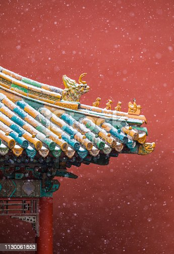 Chinese Traditional style pavilion with Colorful roof In the snow
