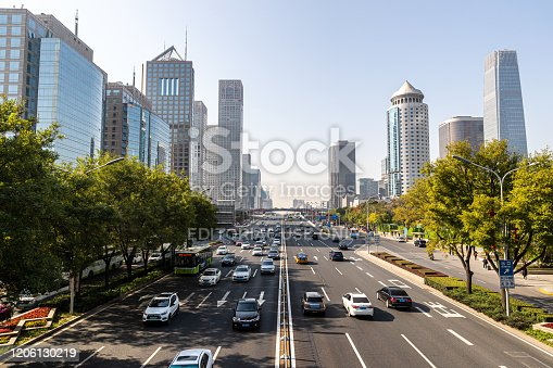 637668332 istock photo Chinese urban high-rise buildings and viaduct roads in Beijing financial district. 1206130219