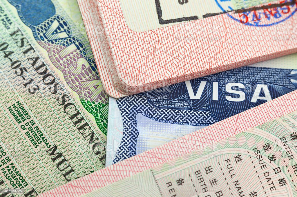 Chinese, USA and Shengen European visas in passports stock photo
