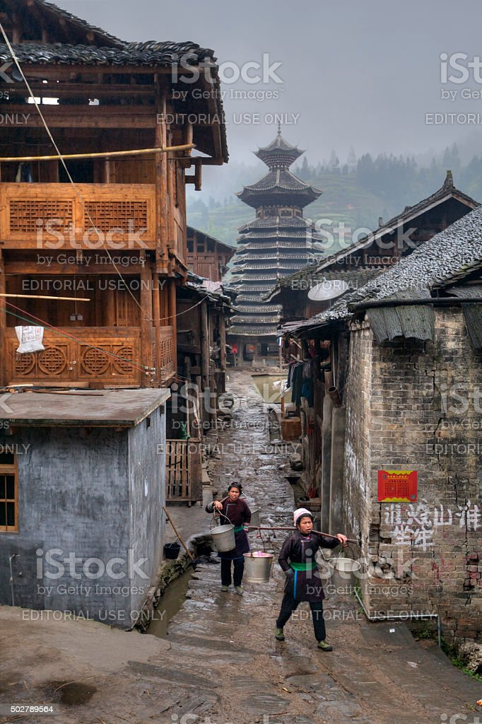 Chinese Village Dong ethnic minority, two women, and Drum Tower. stock photo