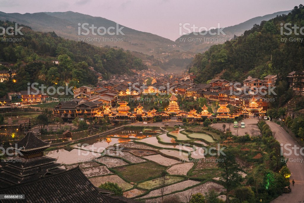 Chinese village with rice terraces at sunrise stock photo