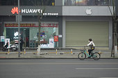 istock Chinese wearing surgical mask riding bike on street 1205654499