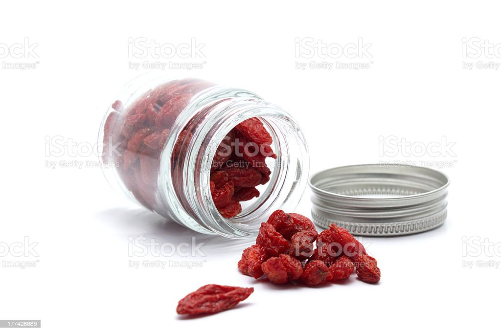Chinese Wolfberry in Bottle on White Background royalty-free stock photo