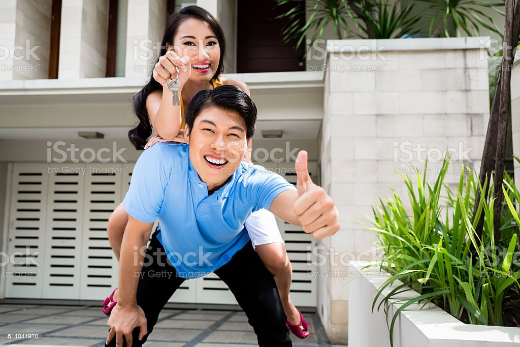 Chinese woman and man enjoying the new home stock photo
