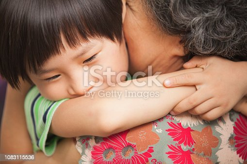 Chinese woman carrying grandson