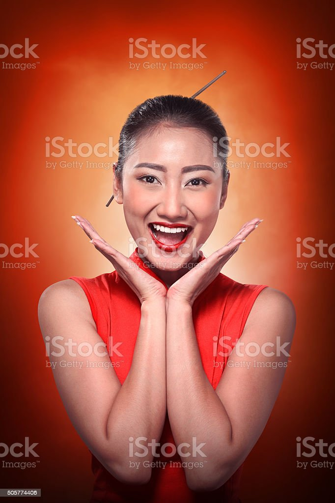 Chinese woman in cheongsam dress - Stock image .