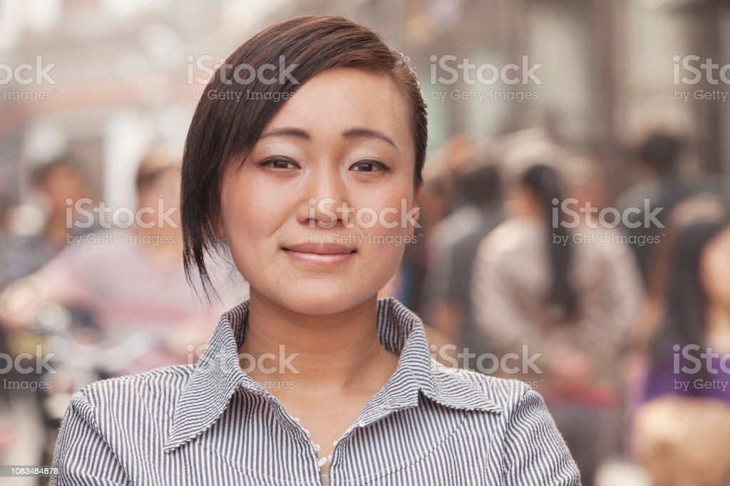 Chinese woman in downtown standing stock photo