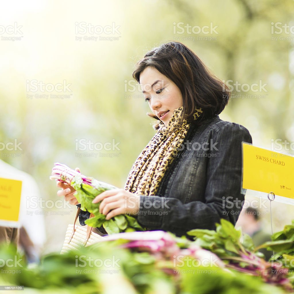 Chinese Woman in Farmers Market stock photo