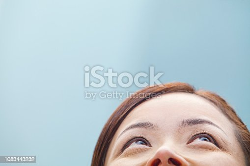 Chinese woman looking up