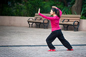 """""""Hong Kong, China - January 17th, 2011: Chinese woman practising Tai Chi in Kowloon park early in the morning."""""""
