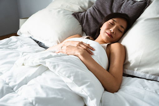 chinese woman sleeping on the bed