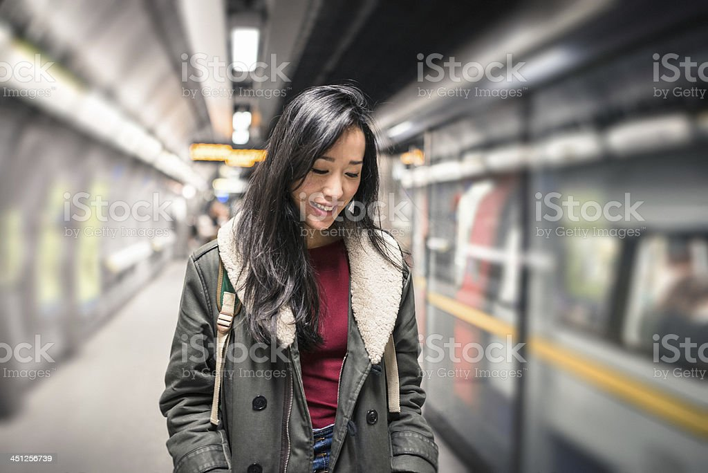 Chinese Woman waiting the metro stock photo