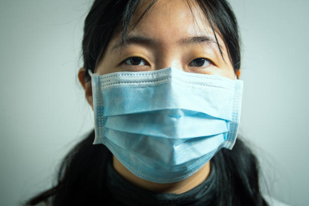 Chinese woman wearing face mask because of virus stock photo