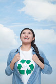 Chinese woman with recycling symbol on t-shirt