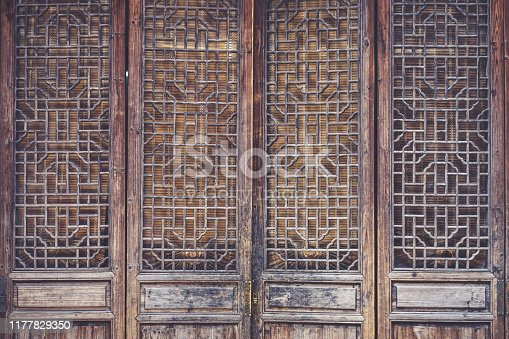 Chinese wooden door. A closed up details of Chinese wooden door in vintage filter.