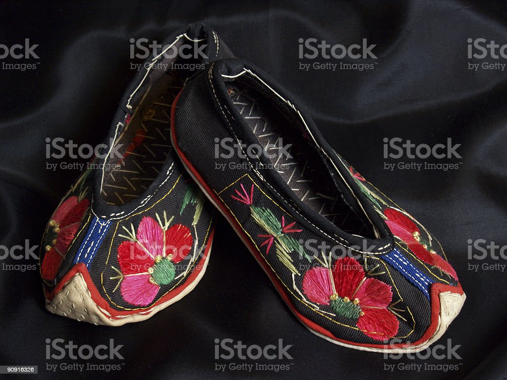Chinese Yi Tribe Baby Shoes with Floral Embroidery stock photo