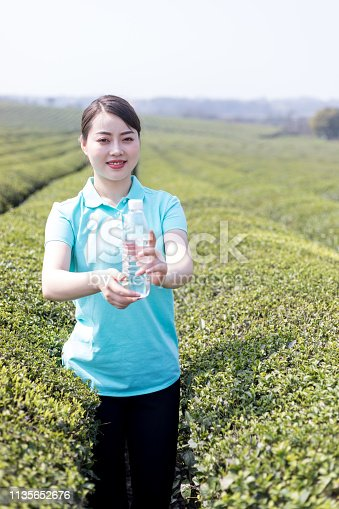 Chinese young girl in tea plantation