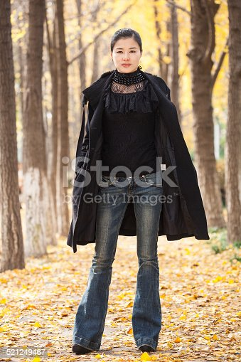 istock chinese young woman enjoy outdoor walk 521249467