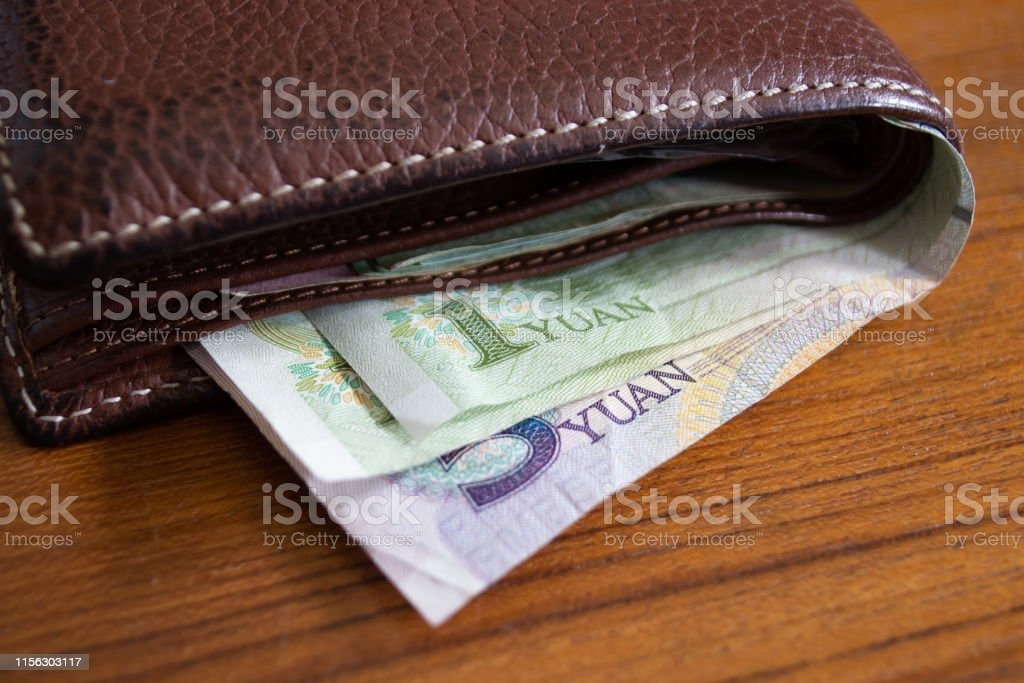 Chinese Yuan banknotes in wallet
