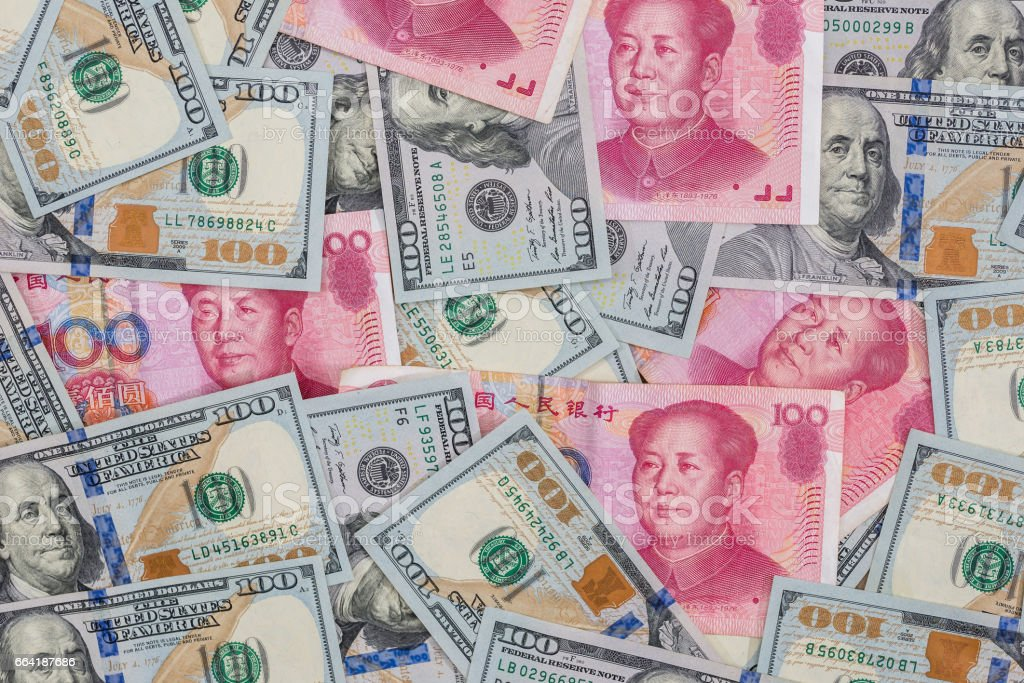 Chinese Yuan bills  vs  U.S. dollar as background . stock photo