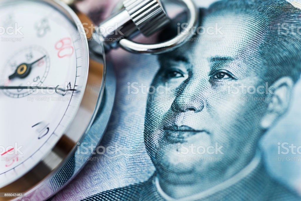 Chinese yuan note and stop watch stock photo