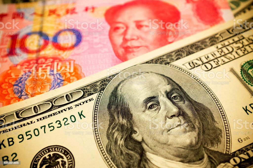 Chinese Yuan Note and U.S. dollar background  (Exchange rate concept) stock photo