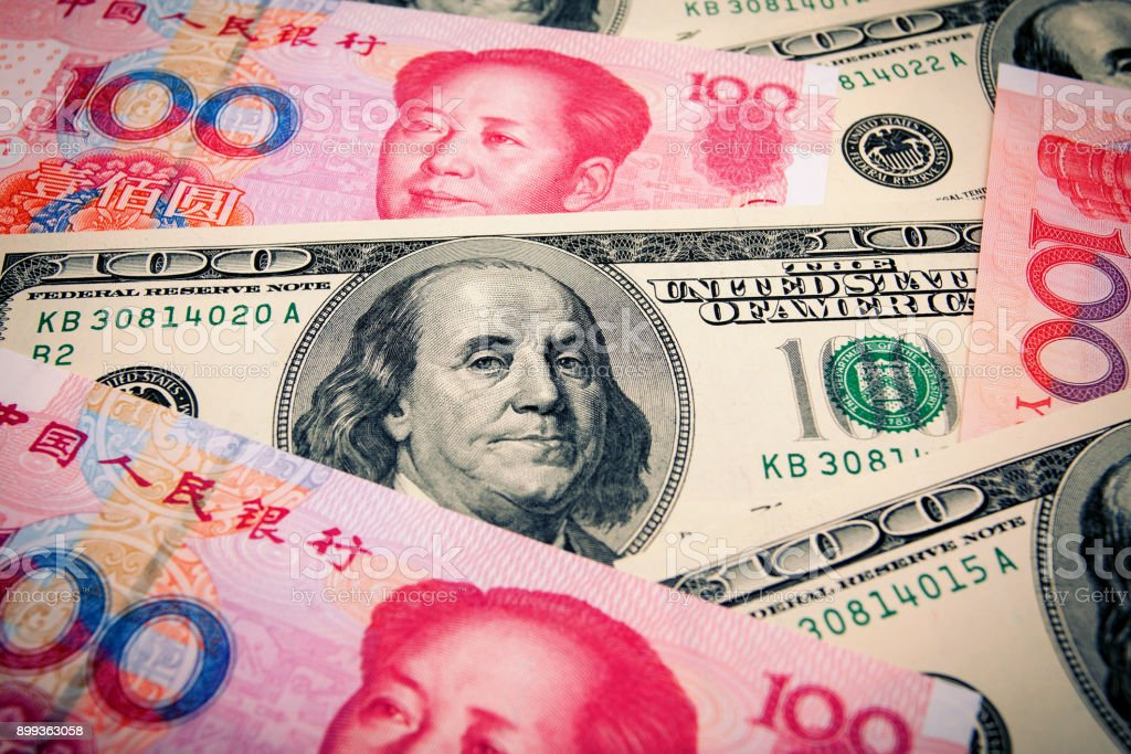 Chinese Yuan Note and U.S. dollar background stock photo