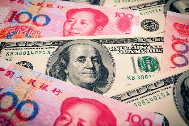 Chinese Yuan Note and U.S. dollar background Chinese Yuan Note and U.S. dollar background chinese currency stock pictures, royalty-free photos & images