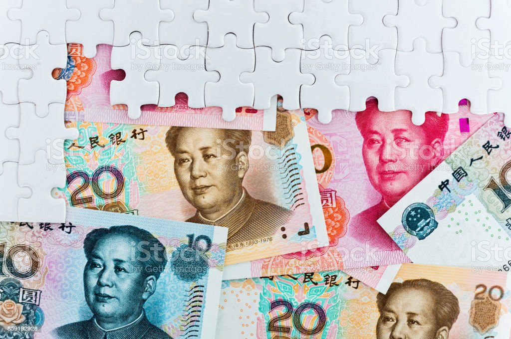 Chinese yuan notes in jigsaw puzzle stock photo