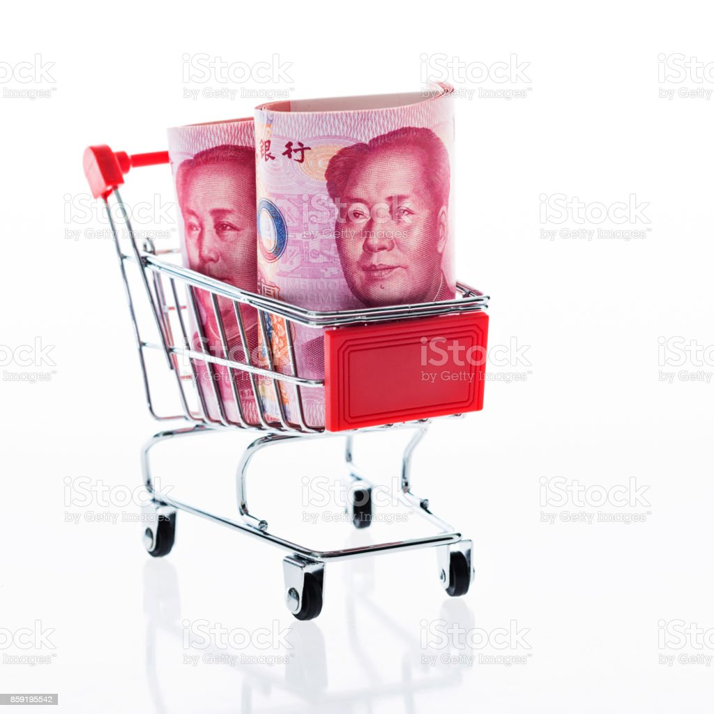 Chinese yuan notes in shopping cart stock photo