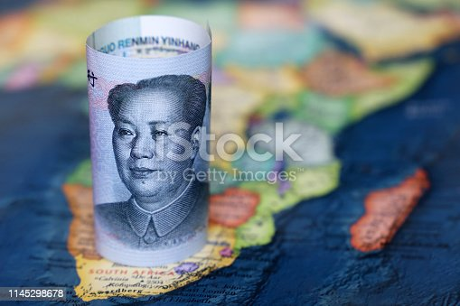 istock Chinese yuan on the map of Africa continent 1145298678