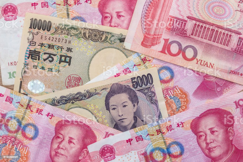Chinese yuan with  Japanese yen as background stock photo