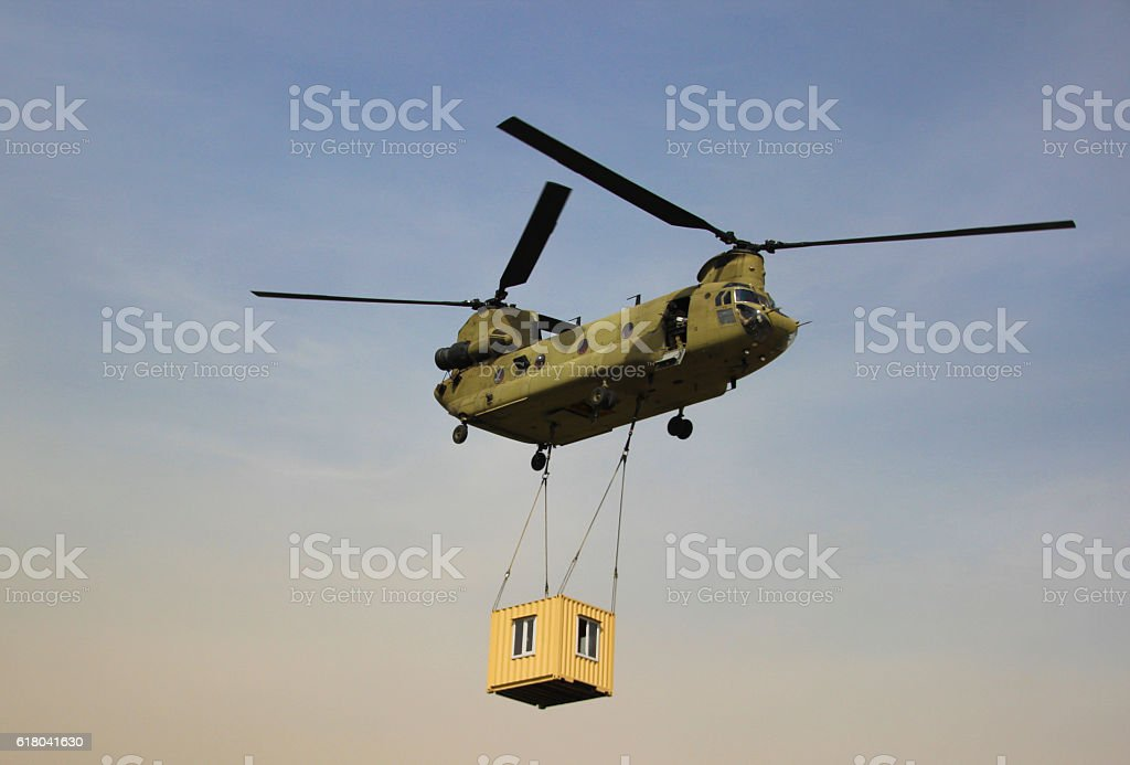 Chinook Carrying a container stock photo